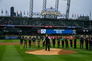 photo of ceremonial first pitch thrown by honoree Dick Vlist at 91 years young